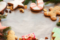 Gingerbread cookies frame on culinary parchment Royalty Free Stock Photos