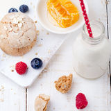 Gingerbread cookies with fresh berries and bottle of milk . Stock Photos
