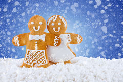 Gingerbread cookies, gingerbread men in the snow on blue background,  template greeting card Stock Image