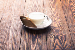 Gingerbread cookies and glass of milk Royalty Free Stock Photo