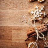 Gingerbread cookies hanging over wooden background Stock Photography