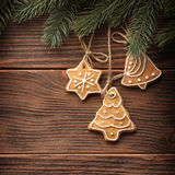 Gingerbread cookies hanging over wooden background Royalty Free Stock Photography