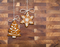 Gingerbread Cookies. Hanging by twine over a wooden background stock photo
