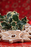 Gingerbread cookies and holly Royalty Free Stock Image