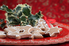 Gingerbread cookies and holly Stock Photography