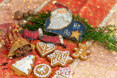 Gingerbread cookies with icing. Cinnamon and Santa Royalty Free Stock Photos