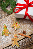 Gingerbread cookies and a little gift for Christmas Royalty Free Stock Photos
