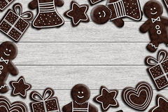 Gingerbread cookies lying on wooden desk Royalty Free Stock Images