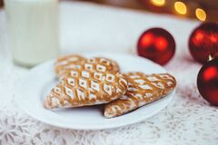 Gingerbread cookies and milk royalty free stock photos