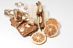 Gingerbread cookies and orange chips. On white Royalty Free Stock Photo
