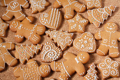 Gingerbread cookies over cork background Royalty Free Stock Photos