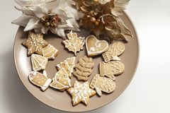 Gingerbread cookies on a plate with Christmas motifs Stock Photo