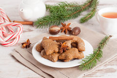 Gingerbread cookies on a plate, surrounded with spices, tea, car Stock Photos