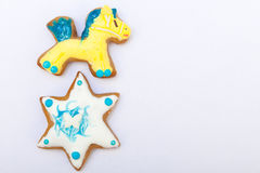 Gingerbread cookies pony star icing decoration. Homemade gingerbread cake pony and star with icing and colorful decoration on white as background. Holiday stock image