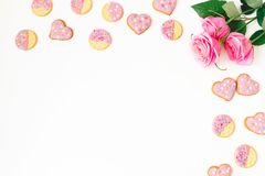 Gingerbread cookies and roses on white background. Flat lay. top view. Gingerbread cookies and roses on white background. Flat lay Royalty Free Stock Photos