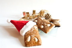 Gingerbread cookies and santa hat. On white Stock Photography