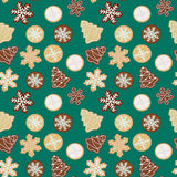 Gingerbread cookies seamless pattern. Illustration of tasty christmas cookies on a green background stock illustration