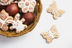 Gingerbread cookies in the shape of an Easter bunny, flowers and butterflies, covered with white and chocolate icing-sugar, and Ea royalty free stock images