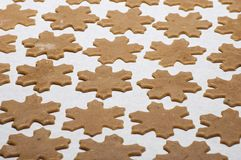 Gingerbread cookies in shape of snowflakes before baking Stock Photos