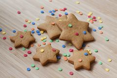 Ginger biscuits on a wooden background royalty free stock photos