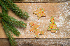 Gingerbread cookies and a small twig Christmas tree Stock Photos
