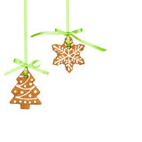 Gingerbread cookies. Gingerbread snowflake and Christmas tree cookies hanging by green ribbon isolated on white stock image