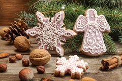 Gingerbread cookies snowflakes, angel, fir tree branch. Christma Royalty Free Stock Photos