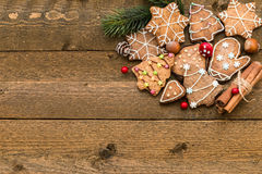Gingerbread cookies, spices and fir branch on wooden background close-up Stock Image