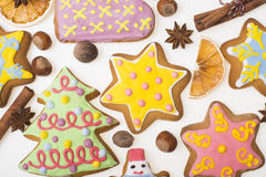 Gingerbread cookies and spices over white background close up. Christmas ginger and honey cookies on isolated white background. Stock Images