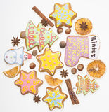 Gingerbread cookies and spices over white background close up. Christmas ginger and honey cookies on isolated white background. Stock Image