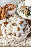 Gingerbread cookies in star shape decorated with almonds Stock Photos
