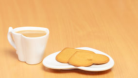 Gingerbread cookies and tea coffee on table. Stock Images