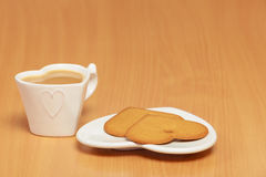Gingerbread cookies and tea coffee on table. Royalty Free Stock Images