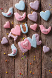Gingerbread cookies for Valentine's day on a wooden. vertical to Stock Photo