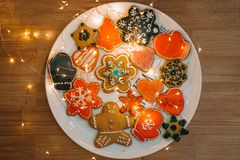 Gingerbread cookies on white dish with golden lights. stock photo