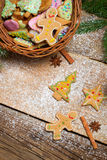 Gingerbread cookies and wicker basket for Christmas Stock Photos