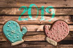 2019, gingerbread cookies on wood background. 2019, gingerbread cookies on wooden background stock image