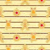 Gingerbread cookies on wood planks vector seamless pattern. Stock Photos