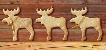 Gingerbread cookies on wooden background.  stock photo