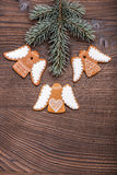 Gingerbread cookies on wooden background. Christmas homemade gingerbread cookies over wooden background Stock Images
