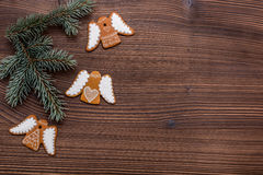 Gingerbread cookies on wooden background. Christmas homemade gingerbread cookies over wooden background Royalty Free Stock Photography