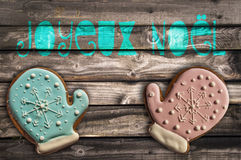 Gingerbread cookies on wooden background and text joyeux noel meaning  merry christmas Royalty Free Stock Images