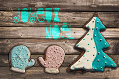Gingerbread cookies on wooden background and text joyeux noel. Meaning  merry christmas in French Stock Photos
