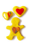 Gingerbread Cooky. Gingerbread cookie dummy and candy yellow and red hearts over white background Stock Photography