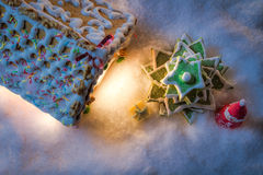 Gingerbread cottage with a Christmas tree and gifts Royalty Free Stock Photo