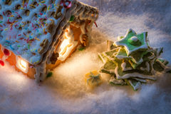 Gingerbread cottage with a gift Stock Image