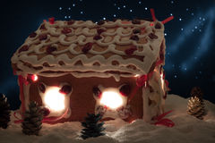 Gingerbread cottage in winter with stars stock photography