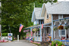 Gingerbread Cottages, Martha's Vineyard, MA, USA. Carpenter Gothic Cottages with Victorian style, gingerbread trim in Wesleyan Grove, town of Oak Bluffs on Stock Photos