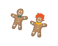 GINGERBREAD COUPLE. Illustrated decorated gingerbread cookie people isolated on a white background Royalty Free Stock Photo
