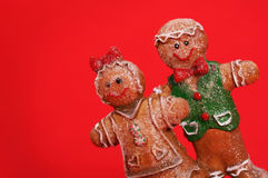 Gingerbread Couple over Red Background. Christmas Cookies Stock Photos